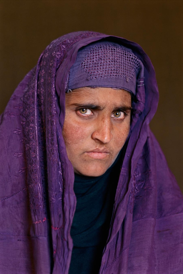 Sharbat Gula, Peshawar, Pakistan, 2002. Her skin is weathered, there are wrinkles now, but she's as striking as the young girl I photographed 17years ago.  Both times our connection was through the lens.  This time she found it easier to look into the